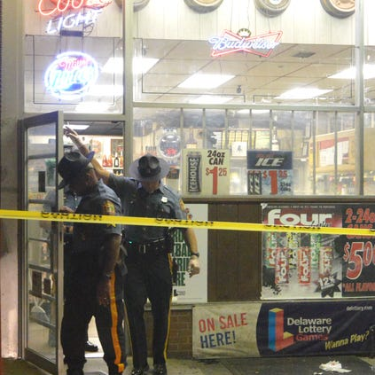 State police investigate at Cutrona Liquors after clerk was shot Thursday night.