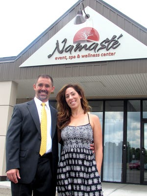 Owners John Maloney and Kimberly Rossi stand outside their new business, Namasté event, spa and wellness center in Horseheads.