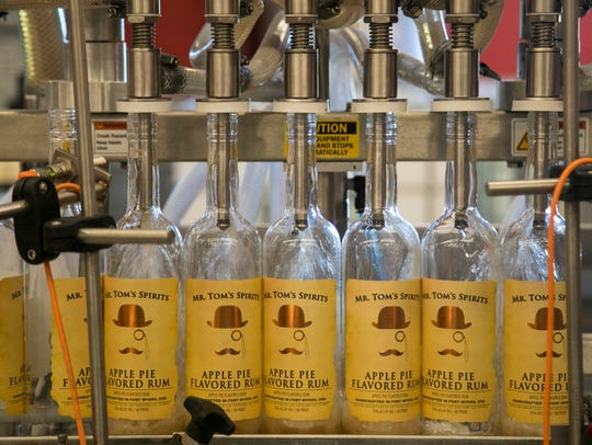 Bottles of Mr. Tom's Spirits Apple Pie Flavored Rum