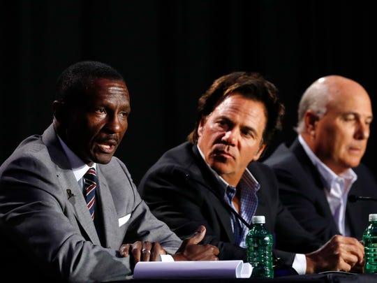 Detroit Pistons head coach Dwane Casey, left, speaks as owner Tom Gores, center, and senior adviser Ed Stefanski listen during a news conference in Detroit, June 20, 2018.