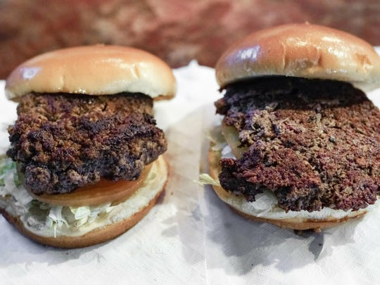 "A conventional beef burger, left, is seen Friday, Jan. 11, 2019, next to ""The Impossible Burger"", right, a plant-based burger containing wheat protein, coconut oil and potato protein among it's ingredients. The ingredients of the Impossible Burger are clearly printed on the menu at Stella's Bar & Grill in Bellevue, Neb., where the meat and non-meat burgers are served."