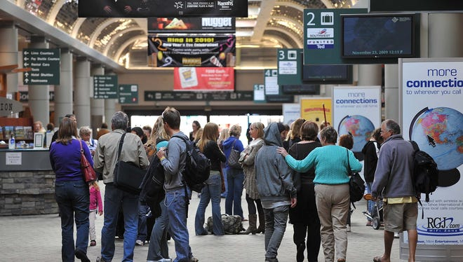 A file photo showing travelers heading to the baggage claim at the Reno-Tahoe International Airport.