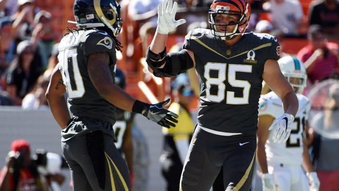 Team Irvin running back Todd Gurley of the Los Angeles Rams (30) celebrates with tight end Tyler Eifert of the Cincinnati Bengals (85) after scoring a touchdown against Team Rice during the 2016 Pro Bowl at Aloha Stadium.
