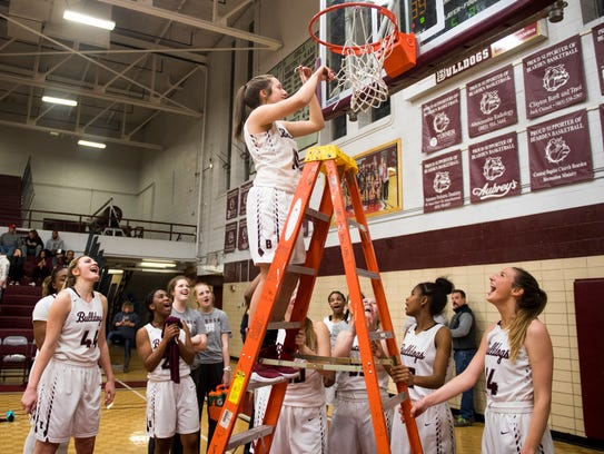 Bearden teammates take turns cutting down the net following