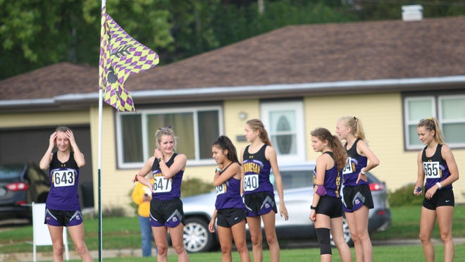 Hononegah's girls cross country team, shown here before a recent meet at Belvidere High School, is the host of Saturday's NIC-10 meet.