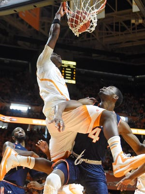Tennessee guard Armani Moore (4) dunks the ball over Auburn center Trayvon Reed (4).