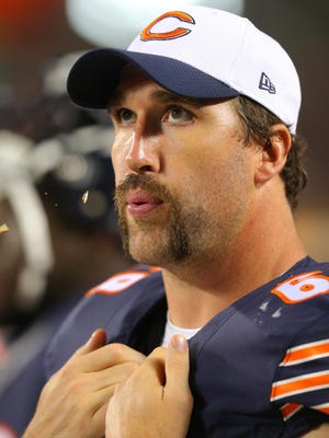 Jared Allen (69) on the bench during the second half of a preseason NFL football game against the Miami Dolphins at Soldier Field.