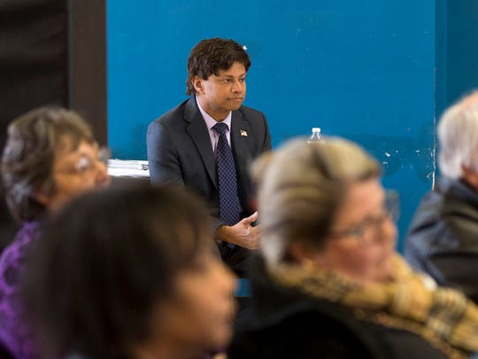 Gubernatorial candidate and Democrat Shri Thanedar waits for his turn to speak during a Castle Rouge Civic Association meeting on Tuesday, April 10, 2018 at the Detroit Leadership Academy in Detroit.