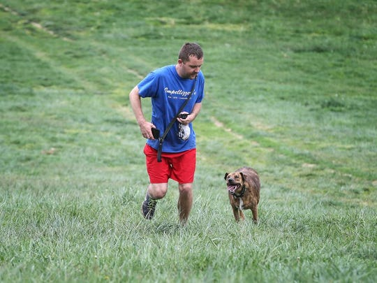 Sam Ault runs with his dog, Slater at Cherokee Park.April 26, 2016