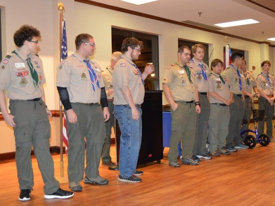 Assistant Scoutmaster David Hayes presents heroic recognition