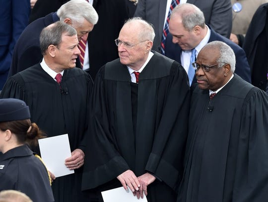 Chief Justice John Roberts, Justice Anthony Kennedy