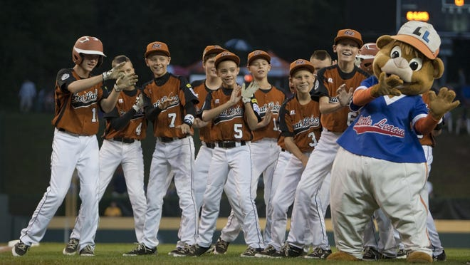 """New Castle's Great Lakes team dances along with mascot """"Dugout"""" before one of its Little League World Series game from 2012. The team inspired its hometown."""