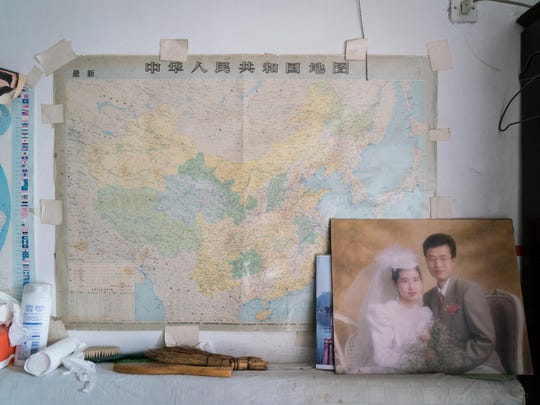 A wedding photo of Han's younger son is displayed in