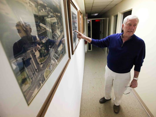 Bruce Greene shows the various photos on the wall of the changes to the store throughout the years. Angerstein's in Elsmere has been in the family for 90 years.