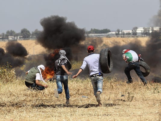 TOPSHOT-PALESTINIAN-ISRAEL-GAZA-CONFLICT-FUNERAL