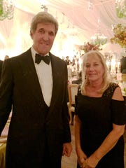 Secretary of State John Kerry poses with Denise Ilitch on Tuesday at the final state dinner of the Obama administration.