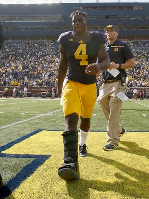 Michigan running back De'Veon Smith walks off the field after a 31-0 win over Brigham Young on Saturday, Sept. 26, 2015, in Ann Arbor.