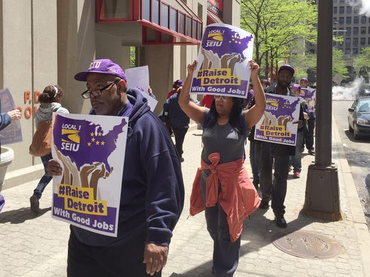 Service Employees International Union workers seeking wage increases demonstrate in New Center on Thursday, May 14, 2015.