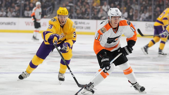 Travis Konecny assisted on both of Sean Couturier's goals in the Flyers' season opener.