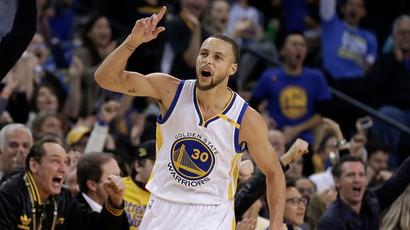 Golden State Warriors' Stephen Curry celebrates a score