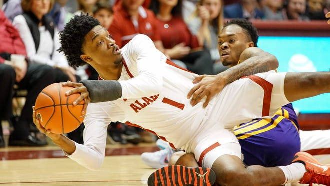 Feb 15, 2020; Tuscaloosa, Alabama, USA; Alabama Crimson Tide forward Herbert Jones (1) struggles for the ball along with LSU Tigers guard Javonte Smart (1) against during the second half at Coleman Coliseum. Mandatory Credit: Marvin Gentry-USA TODAY Sports