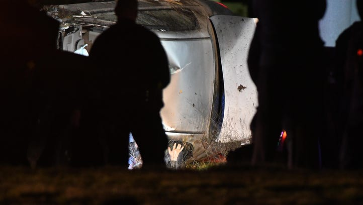 The suspect climbs out of the crashed vehicle after fleeing police during a traffic stop and crashing on Metro Parkway, east of Schoenherr on Monday night.