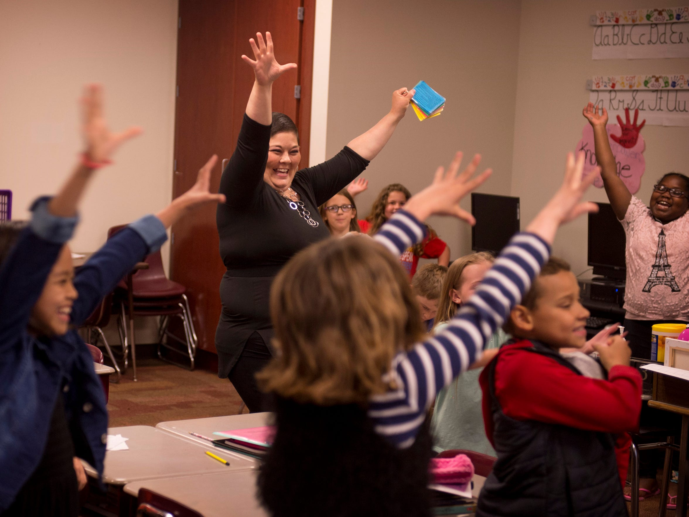 Heather Ota gets her third-graders up and active as they run through vocabulary words at Princeton Community Intermediate School Thursday afternoon. With her chemotherapy regimen, Ota has had to miss chunks of the school year.