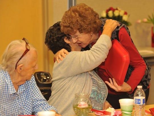 Evelyn Karsten of Visalia, right, hugs Kelly Vanderver