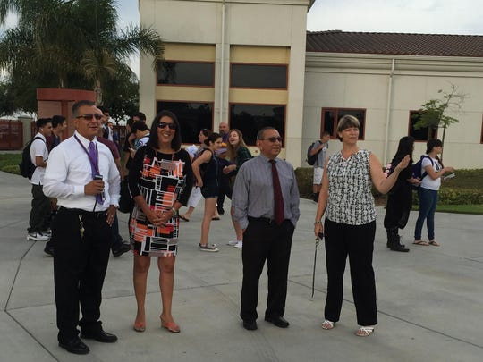 Mission Oak Principal Michele Borges, right, talks with school administrators on Thursday, the first day of school.