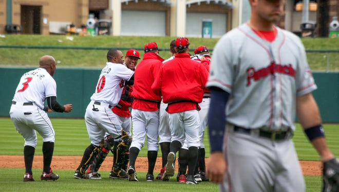 The Indianapolis Indians celebrate a 2-1, 12-inning victory over Pawtucket on Wednesday afternoon at Victory Field.
