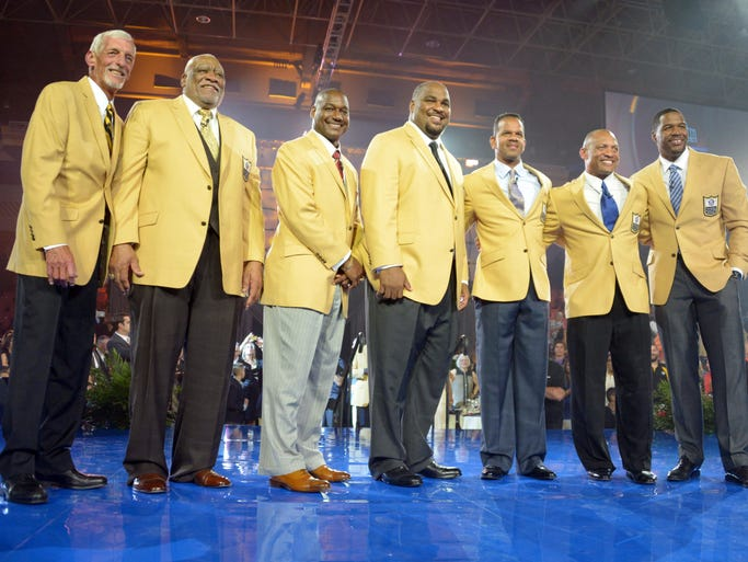 Enshrinees pose at the 2014 Pro Football Hall of Fame Enshrinees gold jacket dinner at Canton Memorial Civic Center. From left: Ray Guy and Claude Humphrey and Derrick Brooks and Walter Jones  and Andre Reed and Aeneas Williams and Michael Strahan.