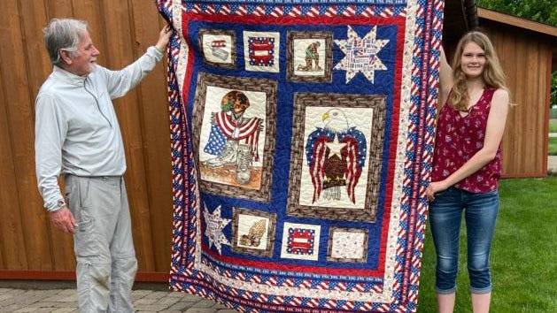 "Rod Winter, a former U.S. Marine Corps member, was recently given a ""quilt of valor"" made by sisters Elissa (shown) and Eva Dynes, both Annawan High School graduates. The quilt was pieced by Elissa, a freshman attending the University of DuBuque, and quilted by Eva. It was Elissa's first quilt and part of a class service project."