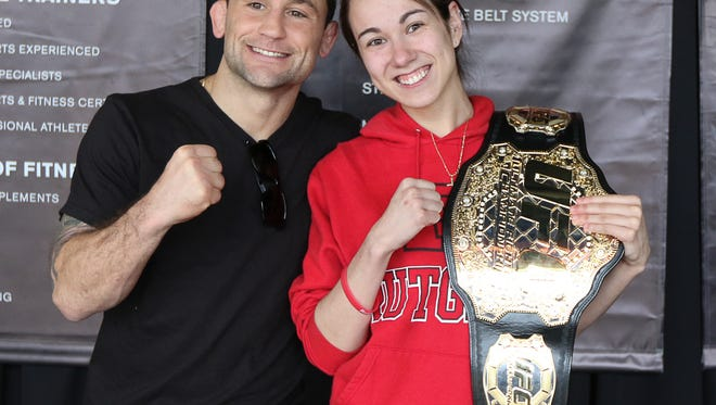 Former UFC Lightweight Champion Frankie Edgar, left, poses with Cristina Pinto of New Brunswick on March 23, 2016.