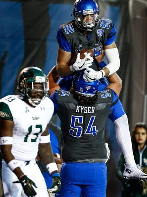 University of Memphis tight end Daniel Montiel (top) celebrates a touchdown with teammate  Drew Kyser (bottom) against University of South Florida during third quarter action at the Liberty Bowl Memorial Stadium.