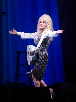 County music legend, Dolly Parton, entertains the capacity crowd at the Bay Center Tuesday night during her Pure and Simple Concert Tour stop in Pensacola.