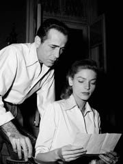 "Humphrey Bogart and Lauren Bacall, Warner Bros. stars, study letter on Jan. 8, 1948 from missing American gold prospector they staked while on location in Mexico last year, for ""Treasure of Sierra Madre."" Grateful prospector promised Bogart a half interest in any gold he found during his search of the Sierra Madres region. (AP Photo)"