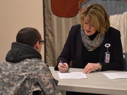 Charles George VA Medical Center director Cynthia Breyfogle participates in the national Point-In-Time Count Jan. 28 at the Asheville Buncombe Community Christian Ministry's Veterans Restoration Quarters.