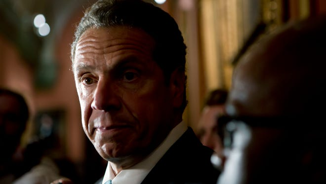 New York Gov. Andrew Cuomo talks to media members outside his office at the state Capitol on Tuesday, May 24, 2016, in Albany, N.Y. (AP Photo/Mike Groll)