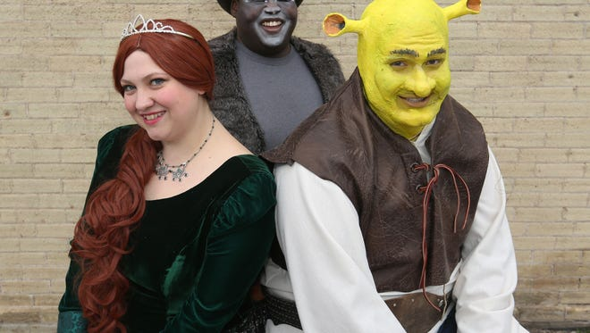 """From left: """"Shrek the Musical"""" characters Princess Fiona, played by Erin LaFond, Donkey, played by Kevin Sievert, and Shrek, played by Zach Glaeser, pose for a portrait before a show rehearsal. Masquers Inc. will perform the popular musical at the Capitol Civic Centre May 12-14."""
