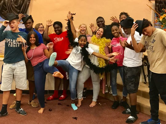 """Taking a break from rehearsals for """"Bye-Bye Betty"""" are, front row, from left, Reese Tooch, Julia Santos, Sinclaire DuPree, Xelny Rios, Kiona Wright, Emmanuel Murray, and Jayden Westberry, and back row, from left, Dashon Lewis, Cerena Westberry, Azariah Murray, Sophie Olsinski, Justin Bailey, and Sydney DuPree."""