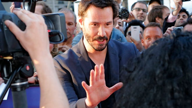 Keanu Reeves meets media at film screening in Paris, June 14.