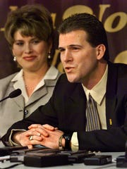 "Steve Alford, who succeeded Tom Davis as the University of Iowa's basketball coach, tells those at this March of 1999 announcement ceremony in Iowa City: ""This is where I would like to call home for a long, long time."" His wife, Tanya, listens at his side. He left after the 2006-07 season to take the New Mexico job and recorded 152–106 at Iowa."