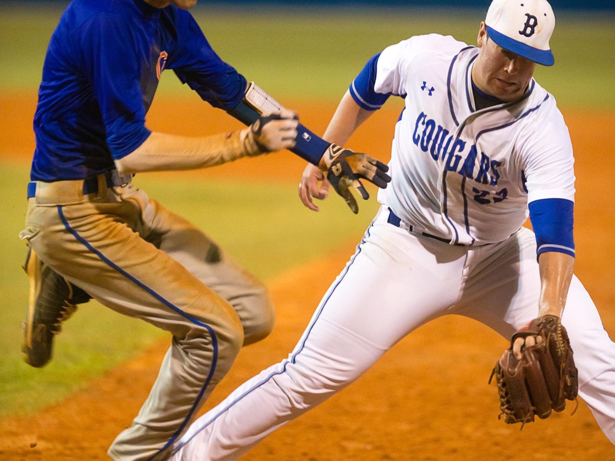 Cape Coral's Kagan Smith slips past the throw to first base to Barron Collier pitcher Logan Langham after a grounder down the first base line in the sixth inning in the Class 6A regional quarterfinal game on Wednesday, April 27, 2016, in North Naples. Barron Collier defeated Cape Coral, 4-3. (David Albers/Staff)