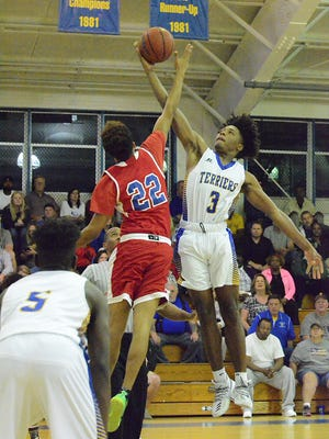 Kario Oquendo (3) wins the opening tipoff against Ony Guerrero (22) Thursday night as Titusville defeated Poinciana at home.