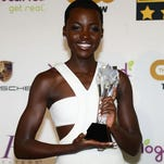 "Lupita Nyong'o, winner of the Best Supporting Actress Award for ""12 Years A Slave"" poses in the press room during Critics' Choice Awards."