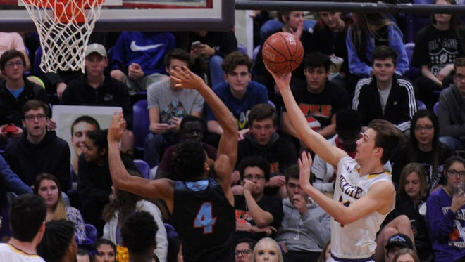 Wylie's Dylan Isenhower goes for a lay up against Hirschi's Javen Banks during Tuesday night's game.
