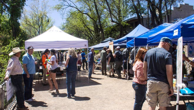 Silver City community members look at booths set up along the Big Ditch during the 2015 Continental Divide Trail Days.