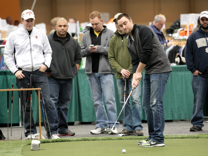 Ryan Scott, Greenwood, puts at a practice green at the day's North Coast Golf Show, which reopens 10-5 at the Indiana Convention Center, Indianapolis, Saturday, January 25, 2014.