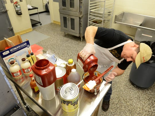 Bill Wheeler, of Howard, Ohio, makes a batch of his barbcue sauce in the Muskingum County Business Incubator. Wheeler owns Road Hog Willy's barbcue and is using the kitchen to expand into packaged sauces.
