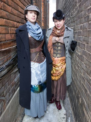 Amanda O'Halloran (left) as Holmes and Liz Bragg as Watson in the Current Theatrics production of 'B*tch of the Baskervilles.'